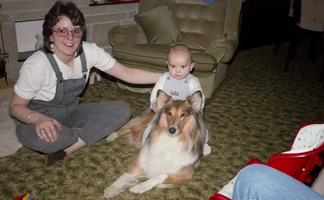 Baby riding a dog